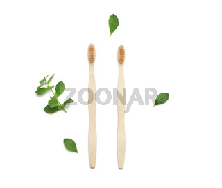two wooden toothbrushes on a white background, plastic rejection concept