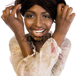 Dark female model fooling with her hair