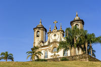 Ancient and historic church in 18th century colonial architecture with towers and palms at Ouro Pret