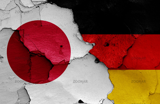 flags of Japan and Germany painted on cracked wall