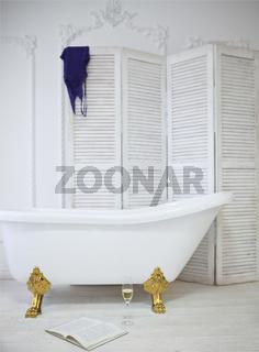 Claw foot bath in a white bathroom