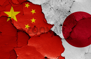 flags of China and Japan painted on cracked wall
