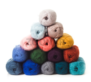 The threads for knitting are folded in the shape of a Christmas tree