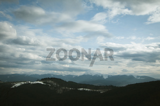Cloudy sky above  mountains