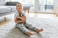 Cute child at home playing with his teddy bear