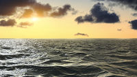 Sunset over the endless horizon of the ocean