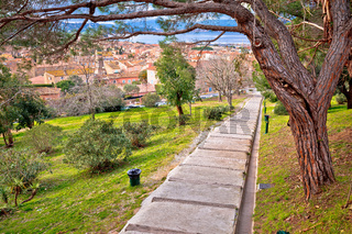 Saint Tropez, French riviera. Town of Saint Tropez green park walkway and architecture view