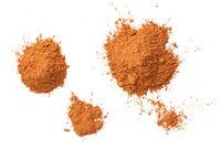 Cinnamon Powder Piles Isolated On White Background