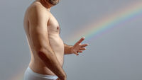 naked man and a rainbow