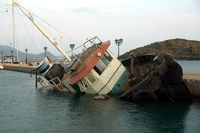 shipwreck in small harbour in greece