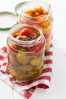 Pickled chili peppers in jar.