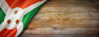 Burundian flag on vintage wood wall banner