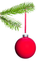 red Christmas tree ball hangs on the fir branch