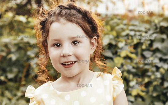 Happy little girl in garden