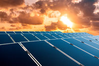 solar energy concept, sunset sky over photovoltaic panels