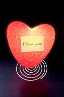 Illuminated night light with heart shape and sticky note and the text I LOVE YOU and place for text