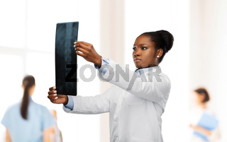 african american female doctor looking at x-ray