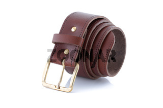 leather belt brown with gold buckle rolled up on a white background with shadow