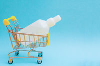 Disinfectant liquid in a white bottle. Therapeutic drug. Disinfection against coronavirus.