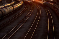 abstract railroad tracks at sunset