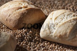 three bread rolls on grain
