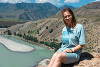 woman on the confluence of two rivers Katun and Chuya in Altai mountains, beauty summer day