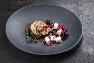 Gravy Greek lamb roast with feta cheese and fruits as minimalistic gourmet meal as closeup in a modern design plate with copy space