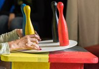 four colorful cones are out of balance on a turntable - Germany