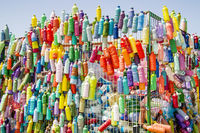 Colorful Recycling Bin With Painted Bottles