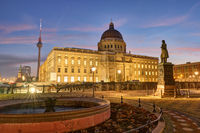 The reconstructed City Palace and the famous Television Tower in Berlin before sunrise