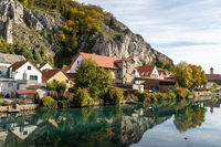 Idyllic view at the village Markt Essing in Bavaria, Germany with the Altmuehl river and high rocks i