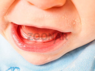 Baby boy showing first teeth