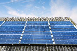 Solar panels in blue color on a roof