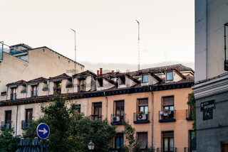 Old residential building with traditional attics in Malasana quarter in Madrid
