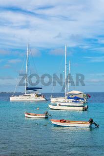 Group of sailing boats on blue ocean at coast