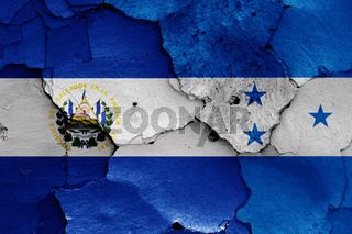 flags of El Salvador and Honduras painted on cracked wall