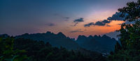 Panorama of Yangshuo landscape from Xianggong Hill viewpoint at dusk