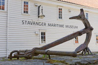 An old anchor displayed in front of Stavanger Maritime Museum entrance in Stavanger Norway