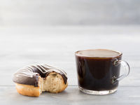 donuts and coffee on gray wooden background , copy space