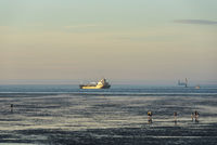 Wadden Sea with world shipping route Elbe by Cuxhaven