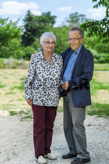 Full body portrait of an 80 year old couple