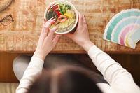 Crop freelancer eating healthy food