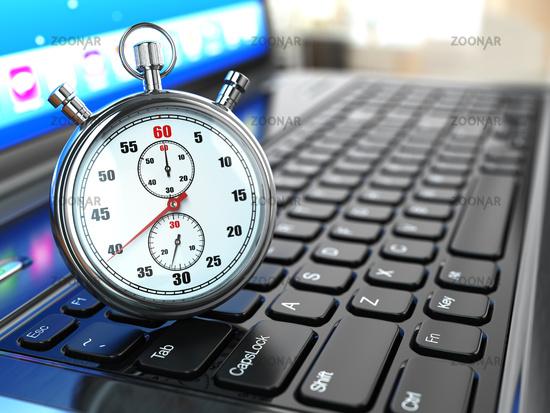 Stopwatch on laptop keyboard.
