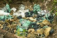 environmental pollution, waste of gas masks and military debris in the woods