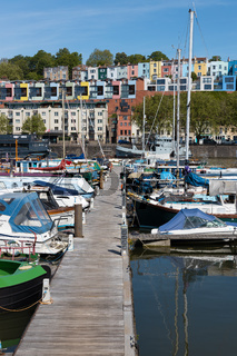 BRISTOL, UK - MAY 14 : View of boats and colourful apartments along the River Avon in Bristol on May 14, 2019