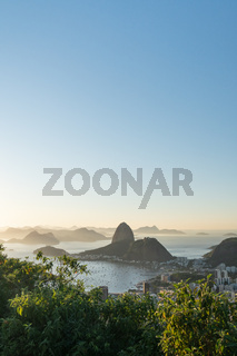 Sunrise view over Sugarloaf Mountain and Guanabara Bay from Mirante Dona Marta in Rio de Janeiro.