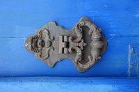 old door knocker on a blue door