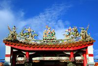 A Chinese temple with colorful decorations of mythological warriors