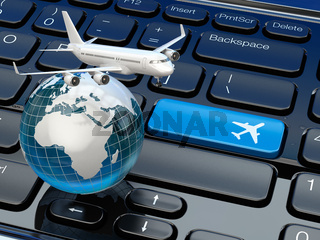 Online ticket booking. Airplane and earth on laptop keyboard.