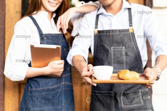 Cafe Owner holdind tablet